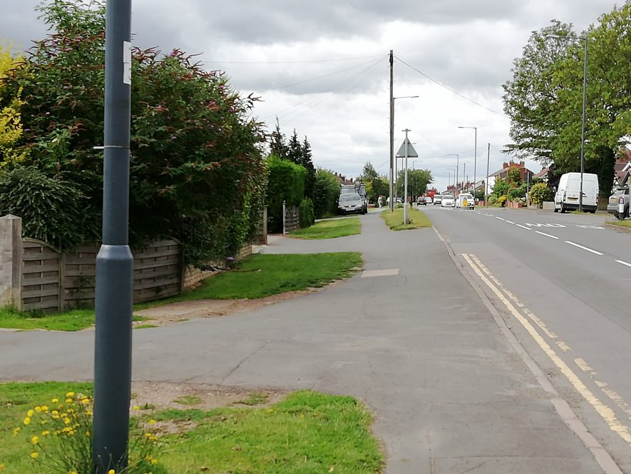 Photo showing driveways to houses on left, pavement and part of road | Image courtesy of Gary Stocker, July 2020