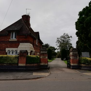 Close up of entrance to cemetery showing two storey redbrick house at entrance   Image courtesy of Gary Stocker August 2020