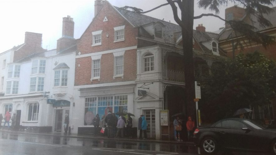Street view of the front of the premises with several people gathered outside. | Image courtesy of Andrew Court