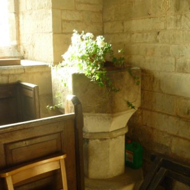 The font in Old Church of St Mary, Ullenhall, 2018. It is not the one pictured on this site in a 1920 photo. | Image courtesy of William Arnold