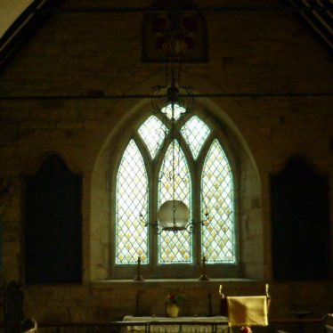 The alter flanked by cast iron boards detailing who is in the vaults not