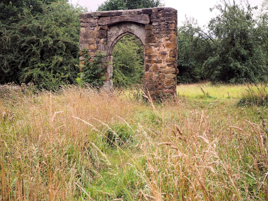 Ruined archway in overgrown grassy field | Image courtesy of Stuart Randle