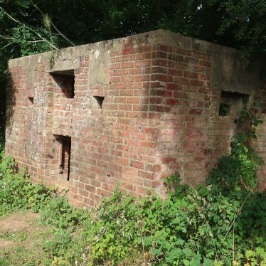 World War Two red brick pillbox, with overhanging trees   Image courtesy of Gary Stocker, 2020