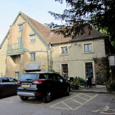 2-storey stone building with tiled roof and 2-storey extension, cars parked in front | Anne Langley