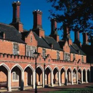 Row of 2 storey almshouses with archways | Warwickshire County Council