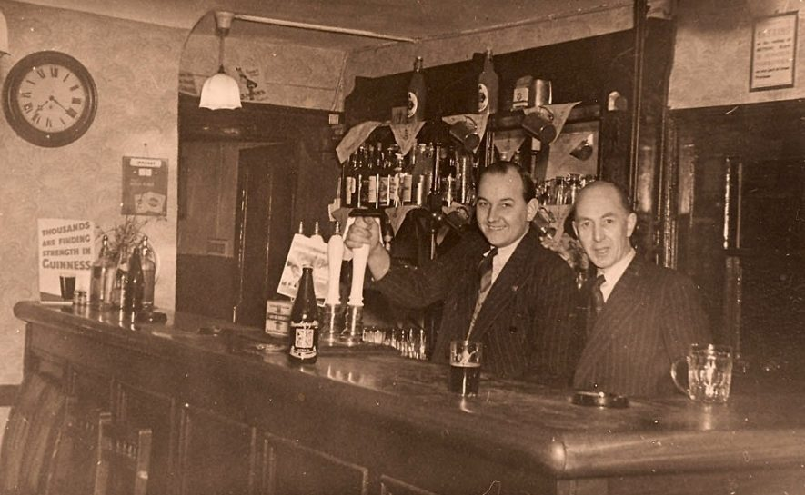 The public bar in the Old Bowling Green. The landlord Mr George Guinness (right) and his son in law Mr Thomas Goode Pratt. c.1953 | The Old Bowling Green Hotel. Rear view of the bowling green, c.1953