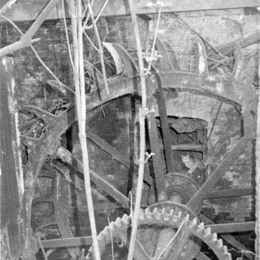 Black and white photo of the iron breast-shot waterwheel, 13ft 6in x 5ft 6in, | June Booth