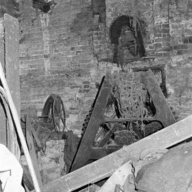 Black and white photo of the iron stand supporting the inner end of the waterwheel shaft and iron spur gear. | June Booth