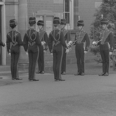 A JLRRA Guard Of Honour outside Nuneaton Museum, dressed in ceremonial uniforms with drawn swords | L. Barnsley Collection