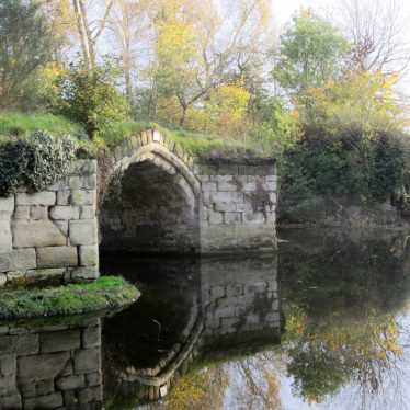 Stone bridge with arch and reflection, autumn colours | Image courtesy of Anne Langley
