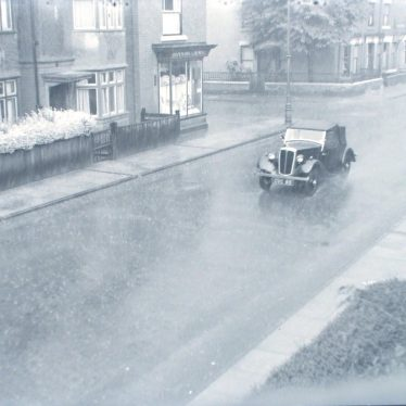 Photograph of a rainy day in Edward Street, Nuneaton. August 1950. | Warwickshire County Record Office reference PH882/1/36