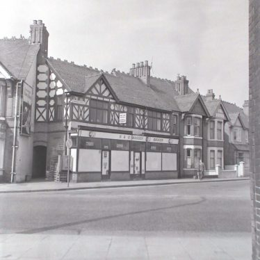 Photograph of Masser's grocery shop at corner of Coton Road and Edward Street (on right), and awaiting demolition, 1971.   Warwickshire County Record Office reference PH882/5/3794