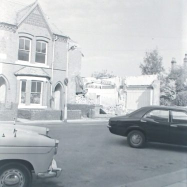 Photograph of demolition work on two houses in Princes St.,(opp. The 'Harcourt' pub) in preparation for new Ring Road, 1974.   Warwickshire County Record Office reference PH882/6/4888