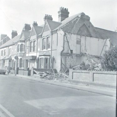 Photograph of demolition work on two houses in Princes St.,(opp. The 'Harcourt' pub) in preparation for new Ring Road, 1974.   Warwickshire County Record Office reference PH882/6/4889