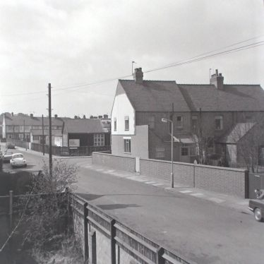 Photograph of view in Frank Street, showing the now empty Mining School, which awaits demolition, 1976.   Warwickshire County Record Office reference PH882/7/5240