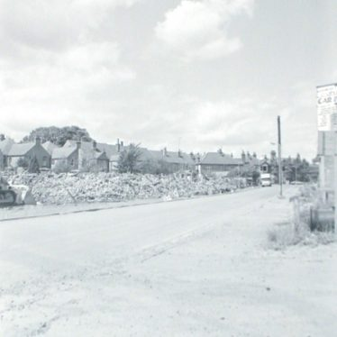 Photograph of Broad Street, showing remains of houses after demolition, 22nd June 1982. | Warwickshire County Record Office reference PH882/8/6801