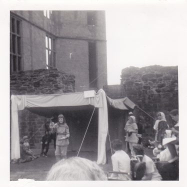 A Mummers' Play being performed at Kenilworth Castle for the 700th anniversary of the Siege in 1966. Actors under a canopy below the Keep. | Ian Sanday