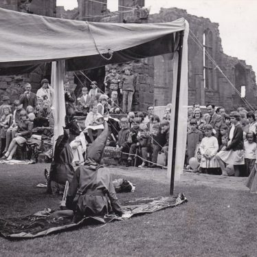 A Mummers Play performed by Kenilworth Brownies and Guides in 1966 with the children in costume under a canopy | Courtesy of the Kenilworth Weekly News