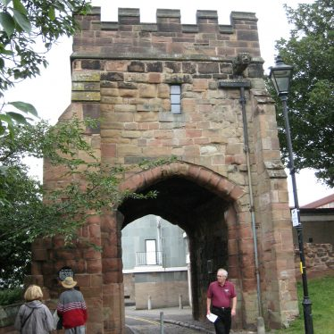 Red sandstone tower gateway with battlements and windows | Image courtesy of Anne Langley