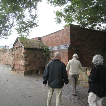 Wall of red sandstone with former turret roofed for use as a small store | Image courtesy of Anne Langley