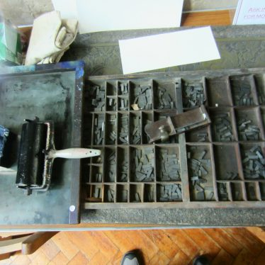Ink, roller and type in sorting tray | Image courtesy of Anne Langley