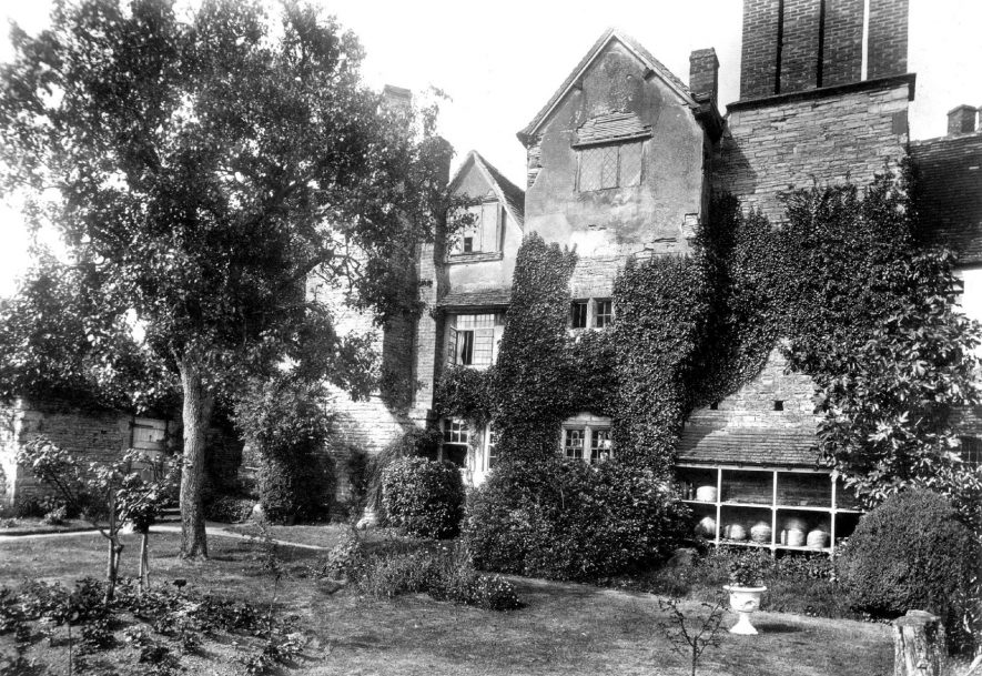 Exterior of The Nunnery, Salford Hall, in the early 20th century. A tree is immediately in front of the building. | Warwickshire County Record Office reference PH117/2