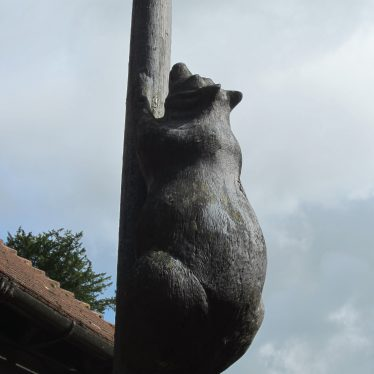 Large carved wooden bear climbing a pole | Image courtesy of Anne Langley