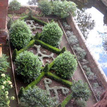 Box hedges and bushes with grey plants making initial letters   Anne Langley