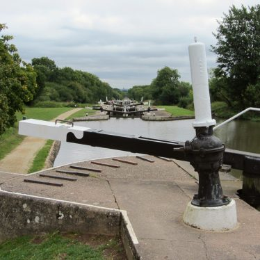 Several locks in distance, in foreground canal basin, beam for opening gate and ridges on ground for leverage | Anne Langley