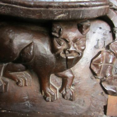 Small carved figure with large mouth, ears, paws and tail | Image courtesy of Anne Langley