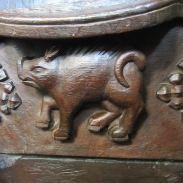 Small wooden figure of pit with snout, hairy back, trotters and curved tail | Image courtesy of Anne Langley