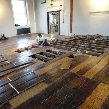 Lifting the floorboards in one of the 1st floor galleries (view from The Bear). | Image courtesy of Andy Isham, Heritage and Culture Warwickshire