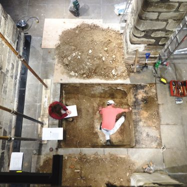 Cathy and Rob from Archaeology Warwickshire, excavating the footprint of the lift. | Image courtesy of Andy Isham, Heritage and Culture Warwickshire