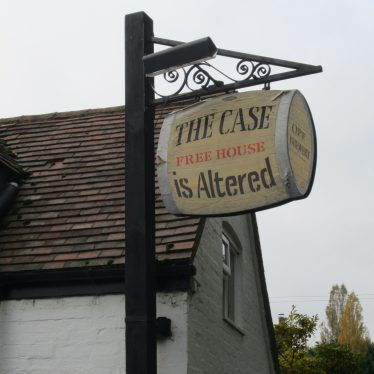Pub sign in the shape of a barrel with 'The Case is Altered Free House' on | Image courtesy of Anne Langley