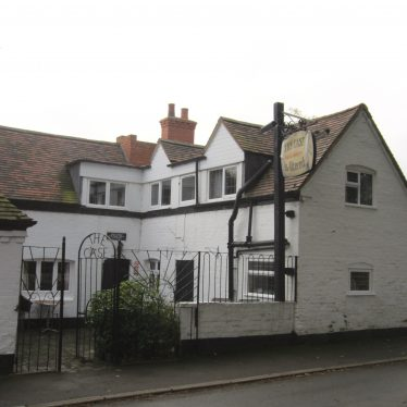 L-shaped, white painted brick, two storey building with tiled roof and pub sign | Image courtesy of Anne Langley