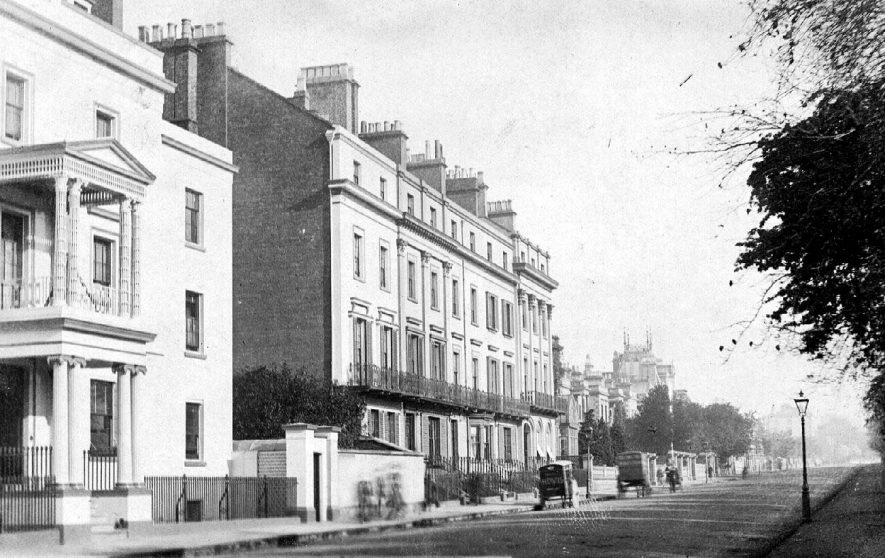 Newbold Terrace, Leamington with two stationary horse-drawn delivery vans.  1900s |  IMAGE LOCATION: (Warwickshire County Record Office)