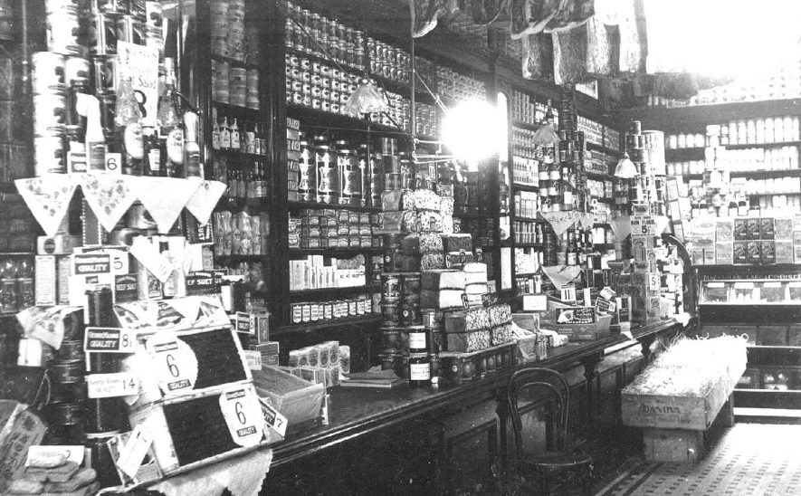 Interior of George Mason's grocery shop at 38, The Parade Leamington Spa.  showing shelves stocked with goods.  1920s |  IMAGE LOCATION: (Warwickshire County Record Office)