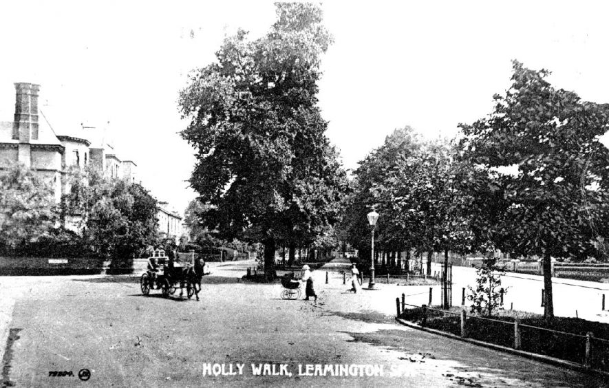 Holly Walk, Leamington Spa, a horse cab on the road and a lady pushing a perambulator.  1900s |  IMAGE LOCATION: (Warwickshire Museum Sites and Monuments Record)