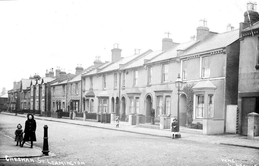 Chesham Street, Leamington Spa. Four children on pavement. Lamp posts and iron bollard.  1900s |  IMAGE LOCATION: (Warwickshire County Record Office)