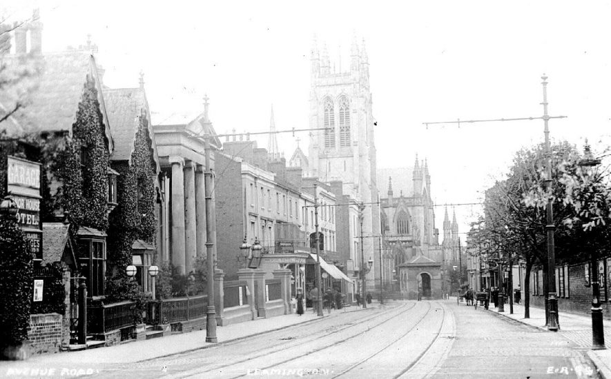 Congregational Church, All Saints Parish Church. The small building at the end of the road is the original spa. Spencer Street, 'Avenue Road', Leamington Spa. Tram lines and overhead electrical system for tramways.  1900s |  IMAGE LOCATION: (Warwickshire County Record Office)
