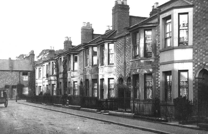 Terraced houses and a milk cart in Comyn Street, Leamington Spa.  1920s |  IMAGE LOCATION: (Warwickshire County Record Office)