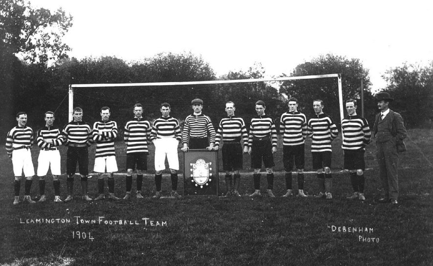 Leamington Spa Town football team, in kit, lined up in front of goalpost. Goalkeeper displaying trophy shield.  1904 |  IMAGE LOCATION: (Warwickshire County Record Office)