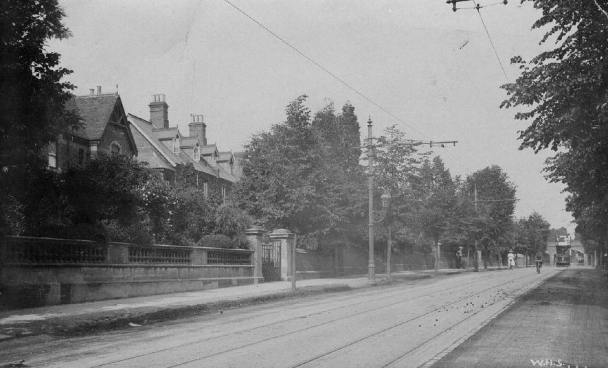 Warwick New Road, Leamington Spa showing tramlines and approaching tramcar.  1900s |  IMAGE LOCATION: (Warwickshire County Record Office)