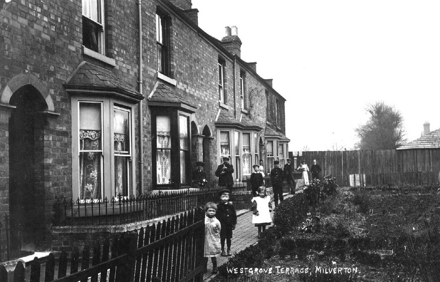 Westgrove Terrace, Milverton. Row of terraced cottages with group of children and adults in front.  1900s |  IMAGE LOCATION: (Warwickshire County Record Office)