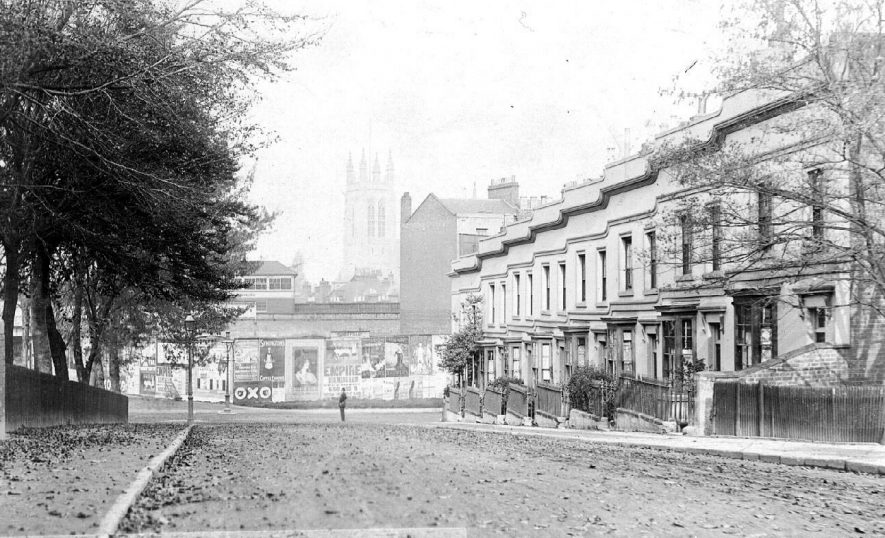 Row of terraced houses in Tachbrook Road with church and railway signal box in the background.  1910s    IMAGE LOCATION: (Warwickshire County Record Office)