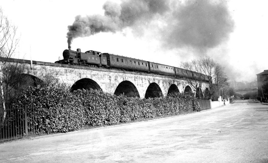 Steam engine and carriages passing over railway bridge.  1938 |  IMAGE LOCATION: (Warwickshire County Record Office)