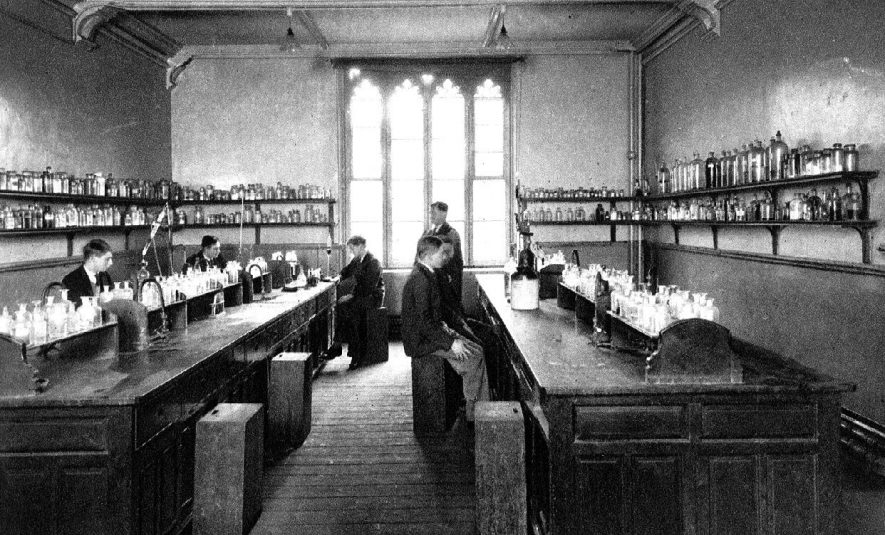 Leamington Spa College in Binswood Avenue. Pupils and teacher in college chemistry laboratory.  1920s |  IMAGE LOCATION: (Warwickshire County Record Office)