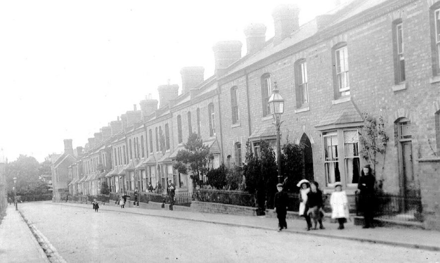 Highfield Terrace, Leamington Spa. Terraced houses, children standing in street, lamp posts.  1900s |  IMAGE LOCATION: (Warwickshire County Record Office)