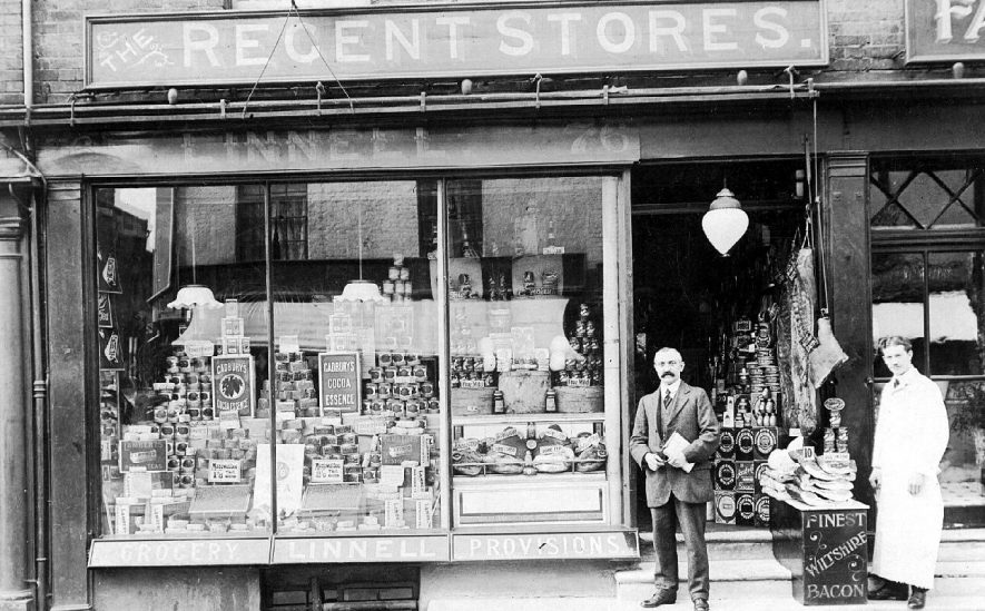 Linnell's Regent Stores shop front with shopkeeper and shopworker standing in front.  1910s |  IMAGE LOCATION: (Warwickshire County Record Office)