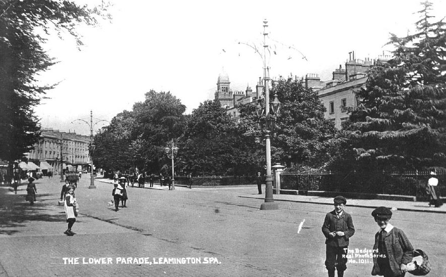The Lower Parade, Leamington Spa with shops and Town Hall in the background and children in the foreground.  1910s |  IMAGE LOCATION: (Warwickshire County Record Office)
